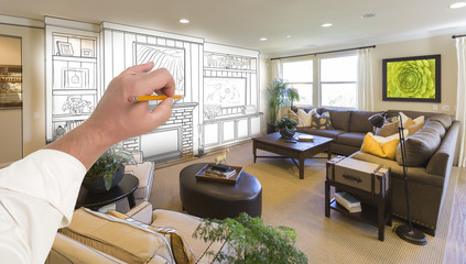 Male Hand Drawing Entertainment Center Over Photo of Home Interior