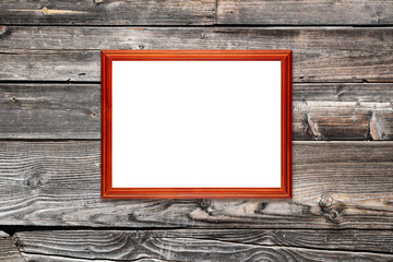 Empty photo frame on wooden wall