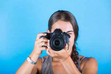 Young woman taking pictures with a professional camera