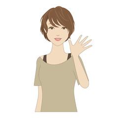 笑顔で手を振る女性