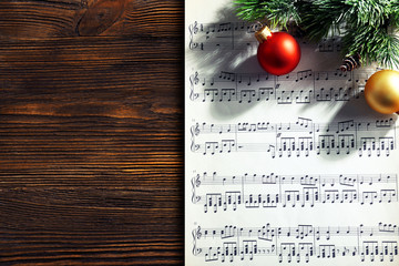 Music and Christmas decor on wooden table