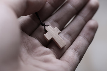Hand Holding The Cross