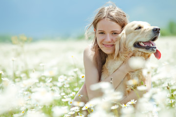 Beautiful girl with dog friend in a wild nature