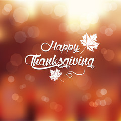 typography Happy Thanksgiving ,autumn blur background