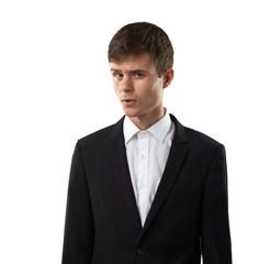 man is lookig suspiciously and distrustfully