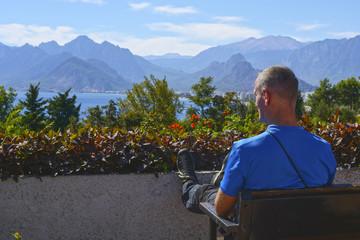 Traveler resting sitting on a bench enjoying the beautiful view