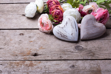 Two decorative white wooden  hearts and flowers