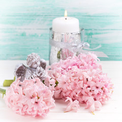 Hyacinths flowers, angel  and candle