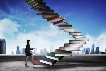 Business person step up flying book that look like stair