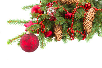 evergreen  tree with red christmas decorations and cones