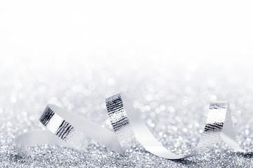 Shiny silver ribbon curls