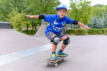 Young boy showing off on his skateboard