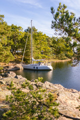 At anchor at one of the small rocky island in the Stockholm arch