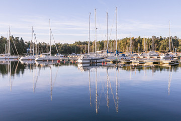Sail Boats on a beautiful cloudless morning in a Swedisch harbou