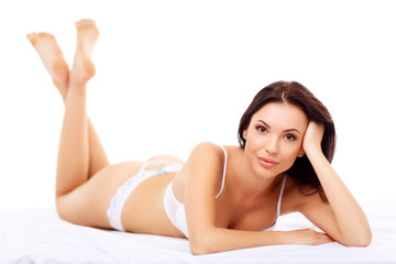 Attractive alluring girl lying on bed