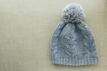Knitted gray hat with pompom