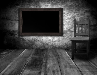 blackboard and wood chair in interior room with gray wooden wall