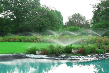 Automatic sprinklers watering grass in park