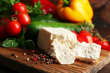 Fresh ingredients for preparing zucchini rolls on wooden background