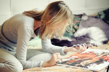 woman draws at home
