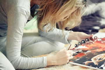 woman draws at home