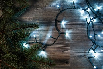 Christmas lights and branches of spruce