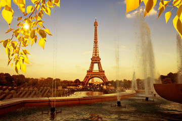 Eiffel Tower (La Tour Eiffel) with fountains. Beautiful sunset landscape in Paris.