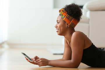 African American woman sending a text message on a mobile phone