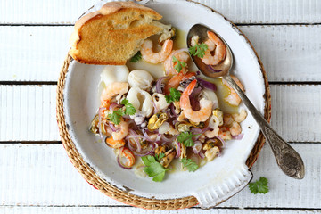 seafood with white wine sauce in pan
