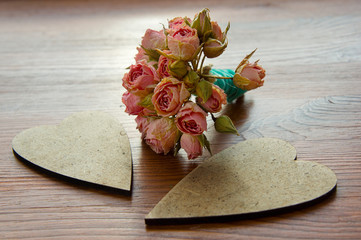 Two decorative vintage heart with a bouquet of flowers