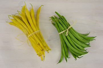 yellow, and green beans on the wooden background