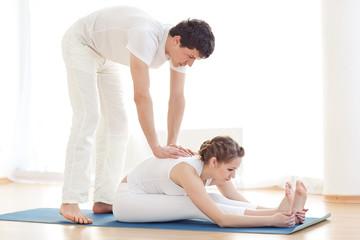 two people in yoga  studio