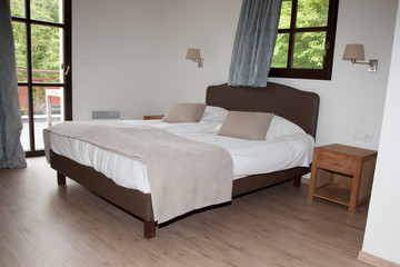 Beautiful bedroom with a big double bed