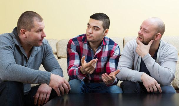 Three men at home