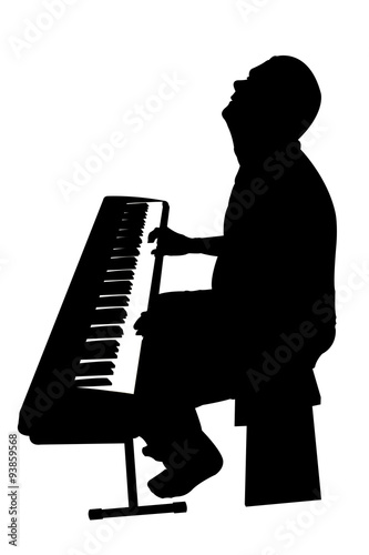 """silhouetted keyboard player playing an electric piano ..."