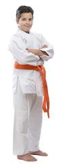 Full length portrait of a orange belt judo kid isolated.