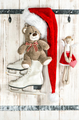 Red Santas hat, Teddy Bear, angel, ice skates. Christmas decorat