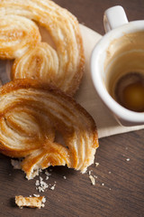 Palmiers sweet and empty coffee cup