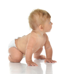 7 month infant child baby toddler sitting or crawling looking at