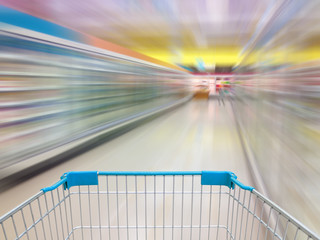 Aisle Milk Yogurt Frozen Food Freezer and Shelves in supermarket