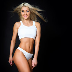 Sports girl on a black background