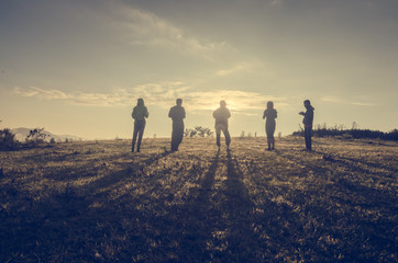 Group Of People standing with Sunrise Concept Wall mural
