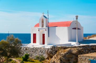 little greek orthodox chapel at the beach in mykonos, greece