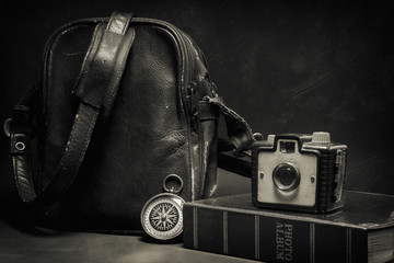Still life of Vintage camera and bag