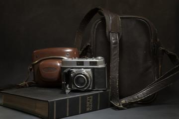 Still life of Vintage camera and bag