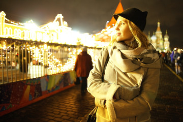 Night portrait of the girl in a winter city
