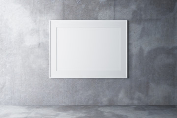 Blank picture frame on concrete wall