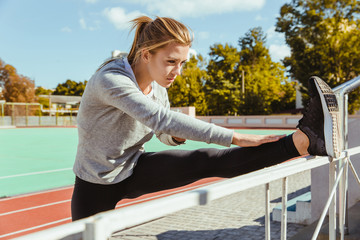 Fitness woman stretching legs