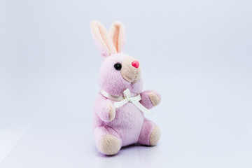 Funny knitted rabbit toy isolated on white background