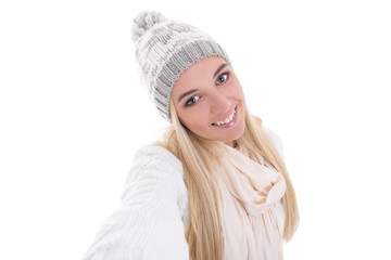 beautiful blond woman in winter clothes taking selfie photo isol